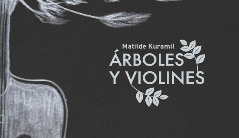 Foto de portada de un libro, aparece un violin y un arbol